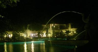Night time view of Siam Beach Swimming pool and the deluxe rooms behind it